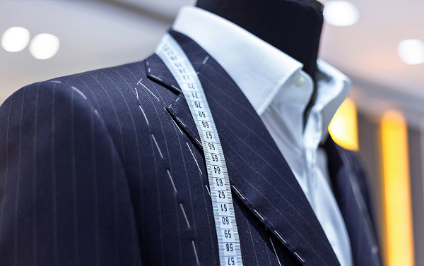 Suit with measuring tape